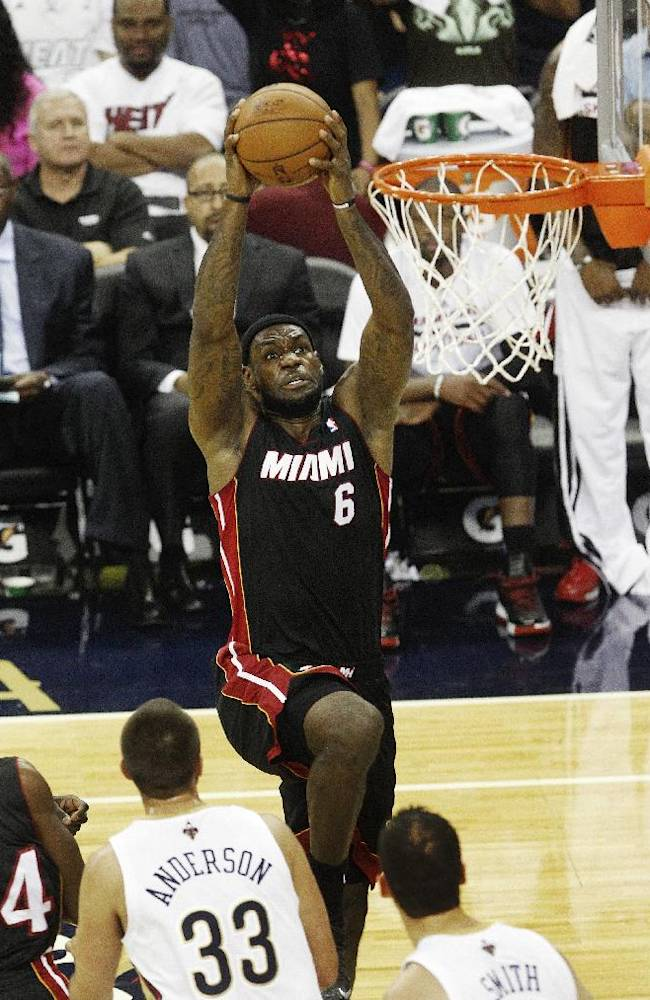 Miami Heat small forward LeBron James (6) drives to the basket against the New Orleans Pelicans in the first half of a preseason NBA basketball game in New Orleans, Wednesday, Oct. 23, 2013