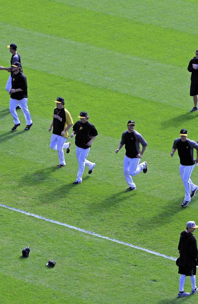 The Pittsburgh Pirates pitching staff warms up before Game 4 of a National League division baseball series against the St. Cardinals at PNC Park in Pittsburgh, Monday, Oct. 7, 2013. The Pirates lead the best-of-five series, two games to one