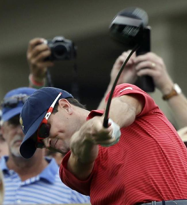 United States team player Zach Johnson tees off the 10th hole during a practice round for the Presidents Cup golf tournament at Muirfield Village Golf Club Wednesday, Oct. 2, 2013, in Dublin, Ohio
