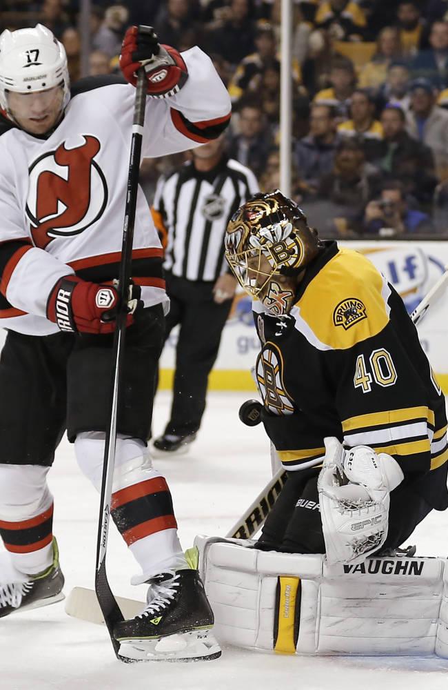 Devils get 2 late goals to stun Bruins 4-3
