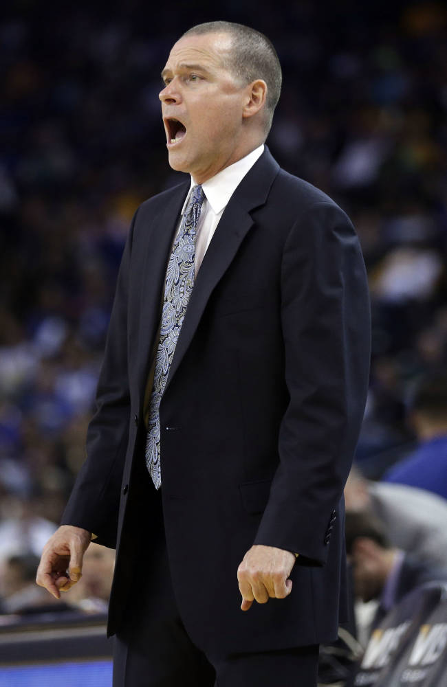 Sacramento Kings coach Michael Malone talks to his players, against the Golden State Warriors during the first half of an NBA preseason basketball game Monday, Oct. 7, 2013, in Oakland, Calif