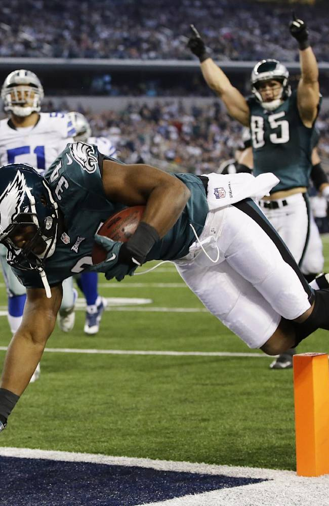 Philadelphia Eagles running back Bryce Brown (34) gets past Dallas Cowboys defensive end George Selvie (99) to score a touchdown during the second half of an NFL football game, Sunday, Dec. 29, 2013, in Arlington, Texas