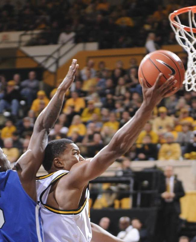 Missouri's Wes Clark,right,, reaches past Oklahoma City's Terence Bonhomme, left, for a shot in the first half in the Hearnes Center on Friday, Oct. 25, 2013
