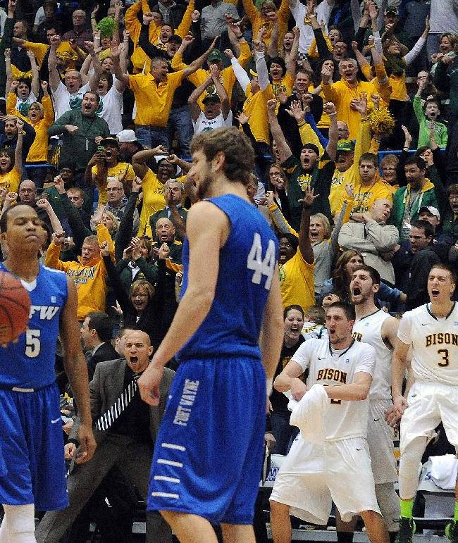 North Dakota State fans cheer after an NDSU score against Indiana-Purdue-Fort Wayne in the closing seconds of an NCAA college basketball game for the Summit League men's tournament title, Tuesday, March 11, 2014, in Sioux Falls, S.D. North Dakota State won 60-57