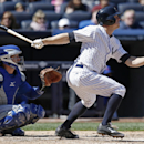Chicago Cubs catcher John Baker, left, watches as New York Yankees Brett Gardner hits a fifth-inning, ground rule double in Game 1 of an interleague baseball doubleheader at Yankee Stadium in New York, Wednesday, April 16, 2014. Gardner later scored on J