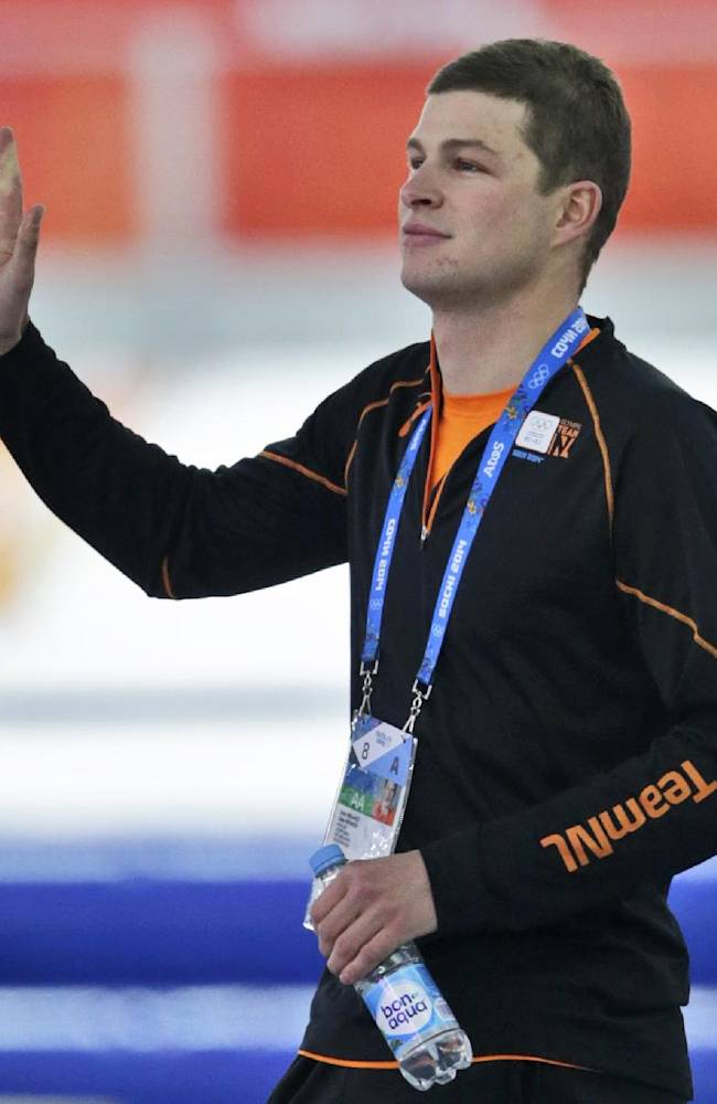 Gold medal favourite Sven Kramer of the Netherlands waves to spectators as he arrives before the start of the men's 5,000-meter speedskating race at the Adler Arena Skating Center at the 2014 Winter Olympics in Sochi, Russia, Saturday, Feb. 8, 2014