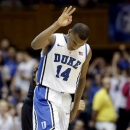 Duke's Rasheed Sulaimon (14) reacts following a 3-pointer against Maryland during the second half of an NCAA college basketball game in Durham, N.C., Saturday, Jan. 26, 2013. Duke won 84-64. (AP Photo/Gerry Broome)