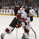 New Jersey Devils' Adam Henrique controls the puck in front of Anaheim Ducks left wing Patrick Maroon during the first period of an NHL hockey game, Friday, Jan. 16, 2015, in Anaheim, Calif The Associated Press