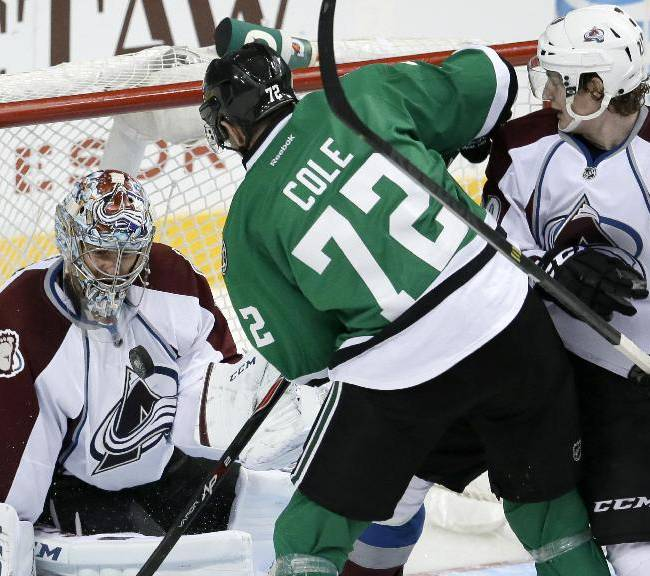 Colorado Avalanche goalie Semyon Varlamov (1), of Russia, watches an airborne puck before gloving it in front of Dallas Stars right wing Erik Cole (72) and the Avalanche's Nathan MacKinnon, right, in the third period of an NHL hockey game, Friday, Nov. 1, 2013, in Dallas. The Avalanche won 3-2 in overtime