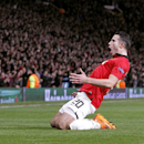 Manchester United's Robin van Persie celebrates scoring his side's third goal and his hat-trick, during the Champions League, Round of 16, second leg match against Olympiakos, at Old Trafford, Manchester, England, Wednesday March 19, 2014. (AP Photo /P