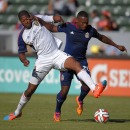 Real Salt Lake defender Chris Schuler, left, and Chivas USA forward Felix Borja battle for the ball during the first half of a Major League Soccer match, Sunday, Oct. 5, 2014, in Carson, Calif The Associated Press