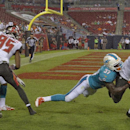 Tampa Bay Buccaneers wide receiver Lavelle Hawkins (15) pulls in a 13-yard touchdown pass from quarterback Mike Kafka as Miami Dolphins defensive back Kevin Fogg (37) defends during the fourth quarter of an NFL preseason football game Saturday, Aug. 16, 2