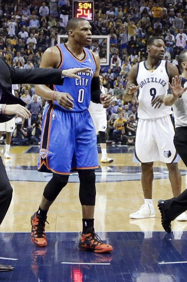 Oklahoma City Thunder head coach Scott Brooks, left, runs onto the court after a scuffle broke out in the second half of Game 6 against the Memphis Grizzlies in an opening-round NBA basketball playoff series Thursday, May 1, 2014, in Memphis, Tenn. Looking on are Thunder guard Russell Westbrook (0) and Memphis Grizzlies guard Tony Allen (9). At right is referee Ken Mauer. Oklahoma City won 104-84 to even the series 3-3