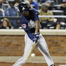 Atlanta Braves' B.J. Upton hits a single during the fifth inning of a baseball game against the New York Mets on Saturday, April 19, 2014, in New York The Associated Press