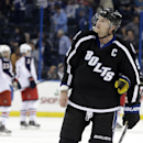 Tampa Bay Lightning center Steven Stamkos (91) reacts as the Columbus Blue Jackets celebrate their 3-1 win over the Lightning during an NHL hockey game Saturday, Dec. 6, 2014, in Tampa, Fla The Associated Press