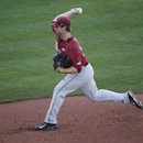 Arkansas pitcher Dominic Taccolini delivers against Florida during the first inning of a Southeastern Conference college baseball tournament game, Friday, May 22, 2015, in Hoover, Ala. (AP Photo/Brynn Anderson)