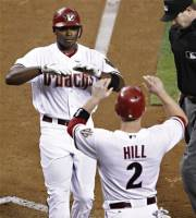 Arizona Diamondbacks' Justin Upton greets teammate Aaron Hill (2) after hitting a two-run home run against the Chicago Cubs during the fifth inning of a baseball game, Friday, Sept. 28, 2012,in Phoenix. (AP Photo/Matt York)