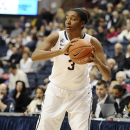 Connecticut's Morgan Tuck looks to pass during the second half of an NCAA college basketball game against Houston, Tuesday, Jan. 7, 2014, in Storrs, Conn. (AP Photo/Jessica Hill)