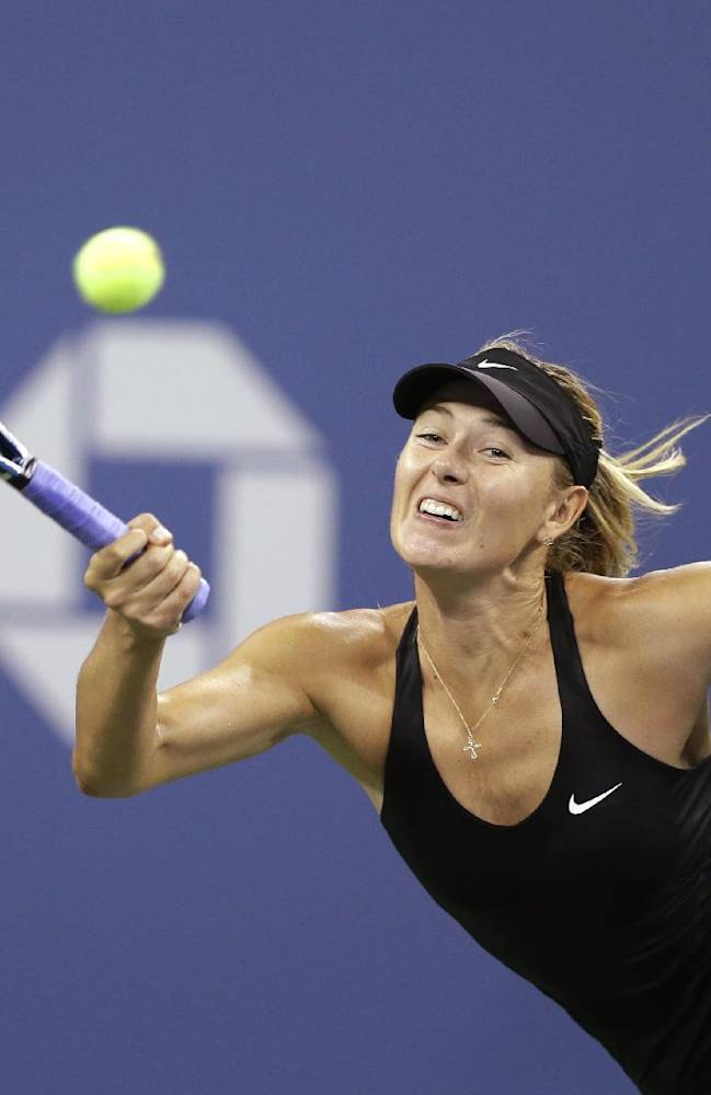 Maria Sharapova, of Russia, returns a shot to Maria Kirilenko, of Russia, during the opening round of the U.S. Open tennis tournament Monday, Aug. 25, 2014, in New York
