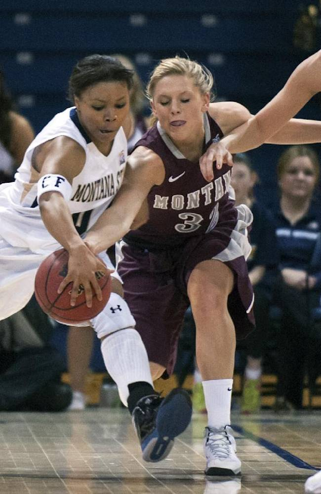 In this photo provided by Montana State University, Montana State guard Ausha Cole, left, and Montana forward Maggie Rickman (32) compete for the ball after a rebound during the first half of an NCAA college basketball game Monday, March 3, 2014, in Bozeman, Mont
