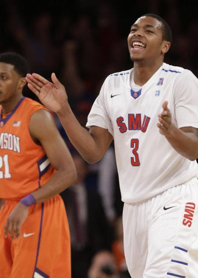 SMU's Sterling Brown (3) and Clemson's Damarcus Harrison (21)react during the second half of an NCAA college basketball game in the semifinals of the NIT Tuesday, April 1, 2014, in New York. SMU won the game 65-59