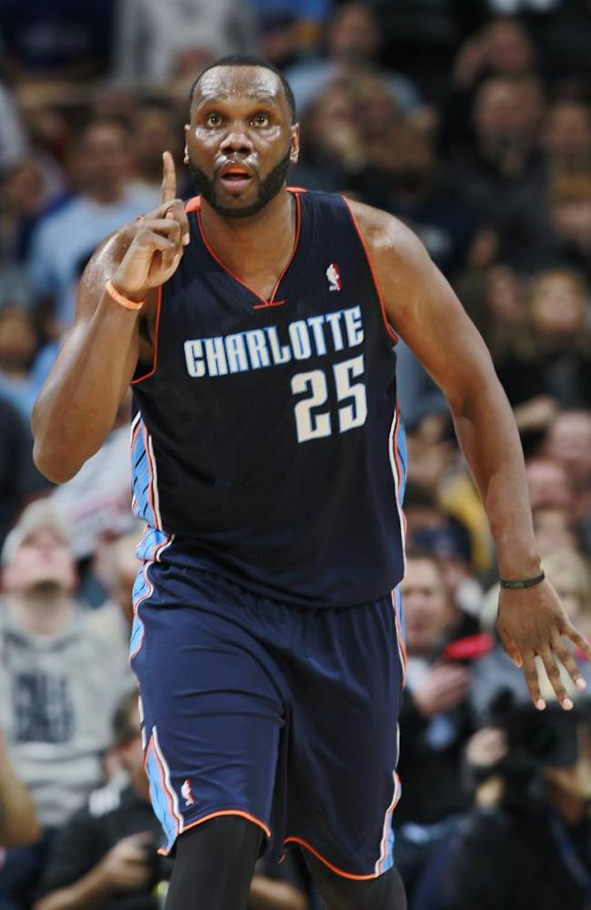Charlotte Bobcats center Al Jefferson reacts after hitting key shot to put the Bobcats ahead of the Denver Nuggets late in the fourth quarter of the Bobcats' 101-98 victory in an NBA basketball game in Denver on Wednesday, Jan. 29, 2014