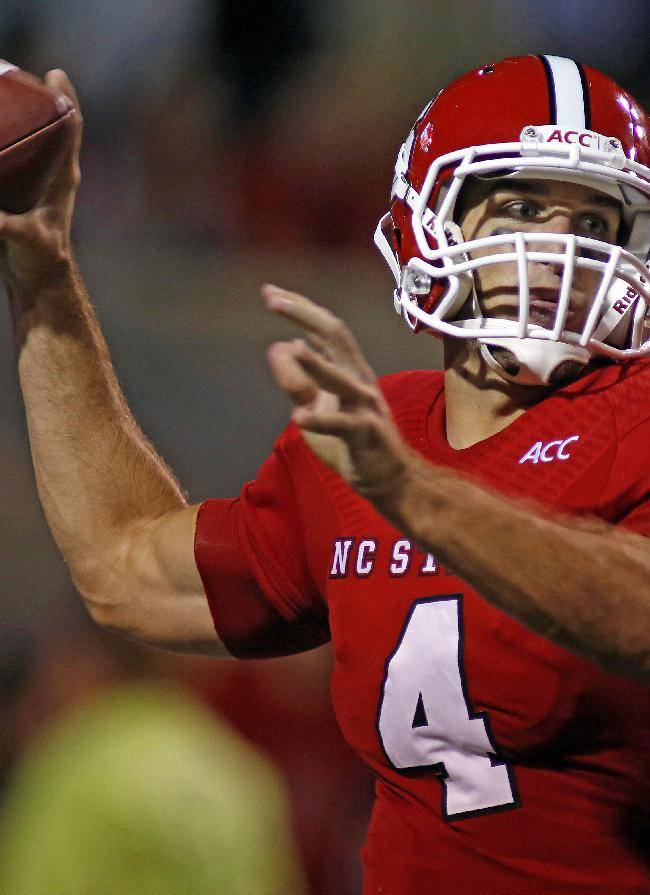 North Carolina State's Pete Thomas (4) prepares to pass during the second half of an NCAA college football game against Clemson in Raleigh, N.C., Thursday, Sept. 19, 2013. Clemson won 26-14