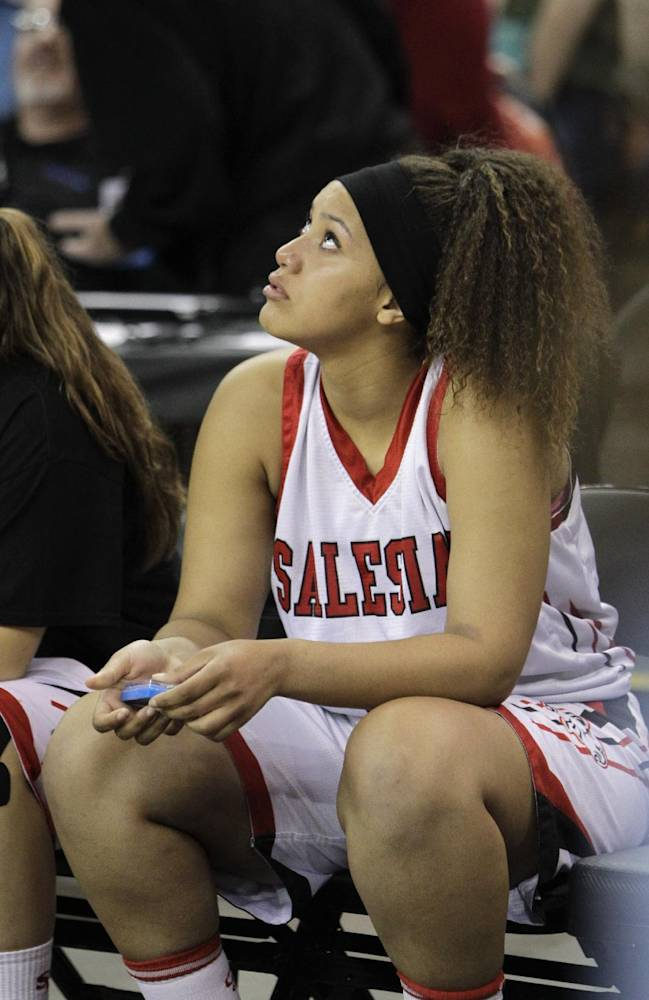 Salesian's Alana Horton looks at the scoreboard after the team's 70-52 loss to Long Beach Poly in the girls' Open Division CIF basketball championship game Saturday, March 29, 2014, in Sacramento, Calif