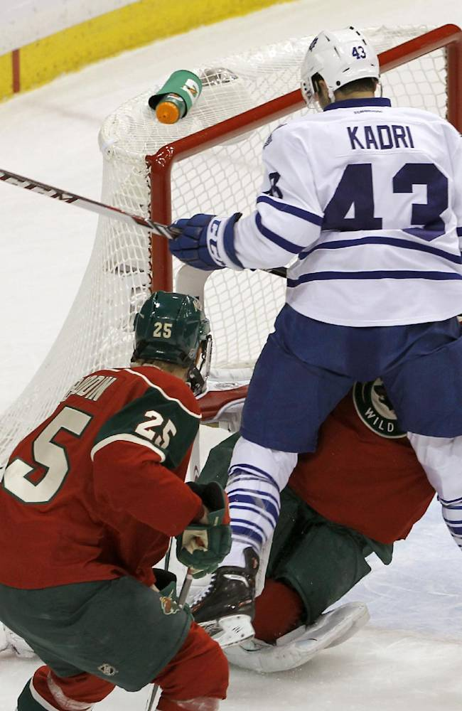 Toronto Maple Leafs center Nazem Kadri (43) collides with Minnesota Wild goalie Niklas Backstrom, of Finland, during the first period of an NHL hockey game in St. Paul, Minn., Wednesday, Nov. 13, 2013. Backstrom left the game later in the period
