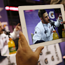 A reporter takes an iPad photo of New England Patriots' Danny Amendola as he answers questions during media day for NFL Super Bowl XLIX football game Tuesday, Jan. 27, 2015, in Phoenix The Associated Press