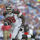 Tampa Bay Buccaneers defensive tackle Clinton McDonald (98) returns a fumble for a touchdown during the first half of a preseason NFL football game against the Buffalo Bills Saturday, Aug. 23, 2014, in Orchard Park, N.Y The Associated Press