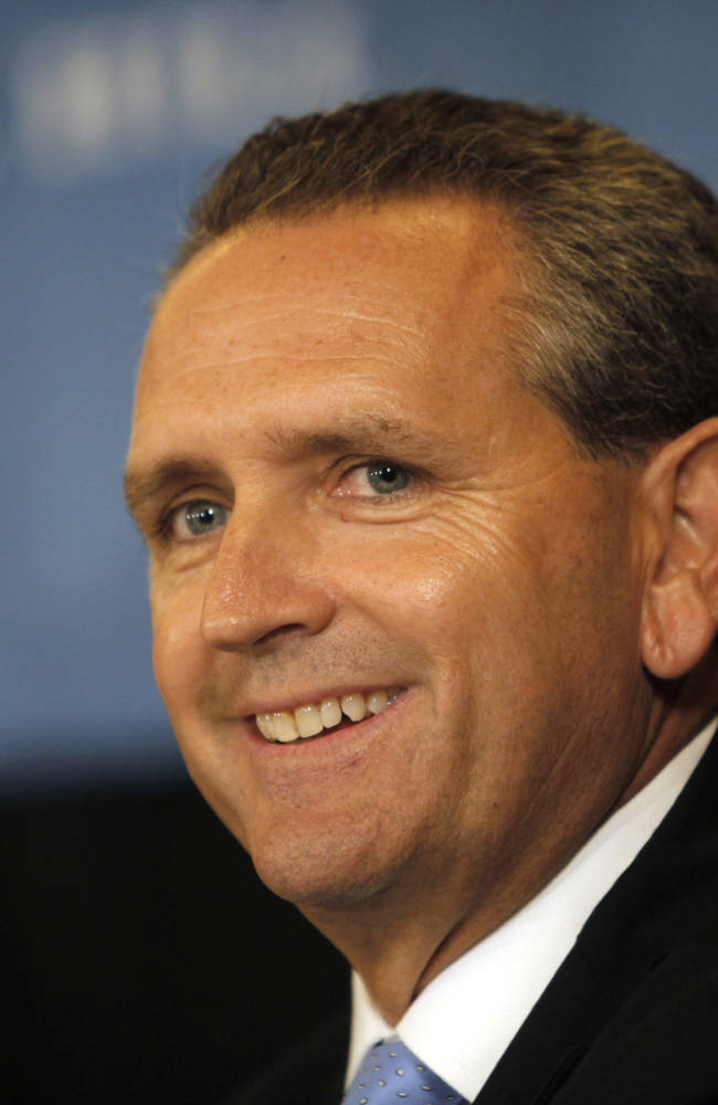 This Oct. 14, 2011 file photo shows Bubba Cunningham smiling during a news conference after being introduced as the new athletic director at the University of North Carolina in Chapel Hill, N.C. After three years of scandal at North Carolina, school officials have spent the past school year conducting a comprehensive review of its academic support programs for athletes