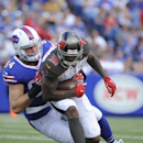 Tampa Bay Buccaneers free safety Dashon Goldson (38) is tackled by Buffalo Bills tight end Scott Chandler (84) after Goldson intercepted a pass during the first half of a preseason NFL football game Saturday, Aug. 23, 2014, in Orchard Park, N.Y The Associ