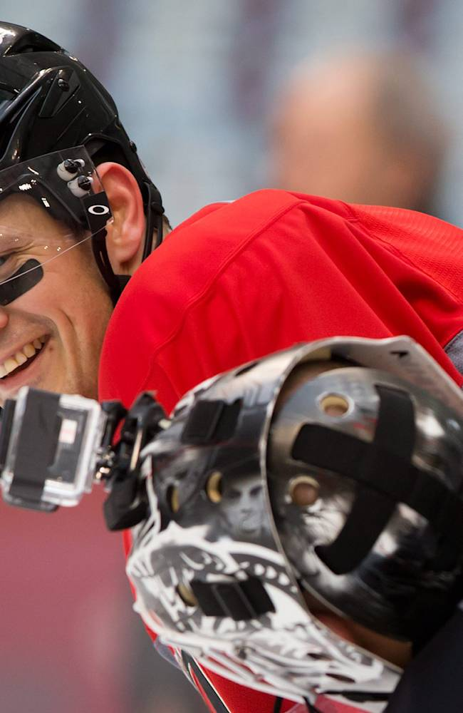 Ottawa Senators' Jason Spezza, top, jokes around for the camera worn by Robin Lehner, of Sweden, during practice for the Heritage Classic NHL hockey game in Vancouver, British Columbia, on Saturday, March 1, 2014. The Senators are scheduled to play the Vancouver Canucks on Sunday