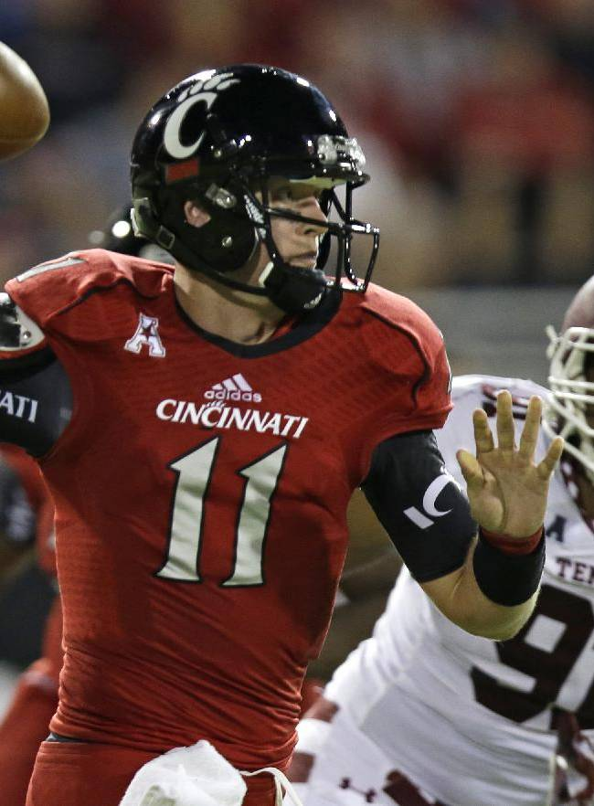 Cincinnati quarterback Brendon Kay (11) passes under pressure from Temple defensive lineman Shahbaz Ahmed (91) in the first half of an NCAA college football game, Friday, Oct. 11, 2013, in Cincinnati
