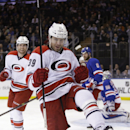 Carolina Hurricanes' Patrick Dwyer (39) and Brett Bellemore (73) celebrate after Dwyer scored a goal during the first period of an NHL hockey game against the New York Rangers on Tuesday, April 8, 2014, in New York The Associated Press