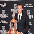 In this photo provided by the Las Vegas News Bureau, Tuukka Rask of the Boston Bruins poses with the Vezina Trophy as the league's top goalkeeper at the 2014 NHL Awards at Wynn Las Vegas. Tuesday, June 24, 2014 The Associated Press
