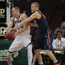 Saint Mary's Beau Levesque, left, fights for a rebound against Pepperdine's Malte Kramer in the second half of a quarterfinal West Coast Conference NCAA college basketball tournament game, Saturday, March 8, 2014, in Las Vegas The Associated Press