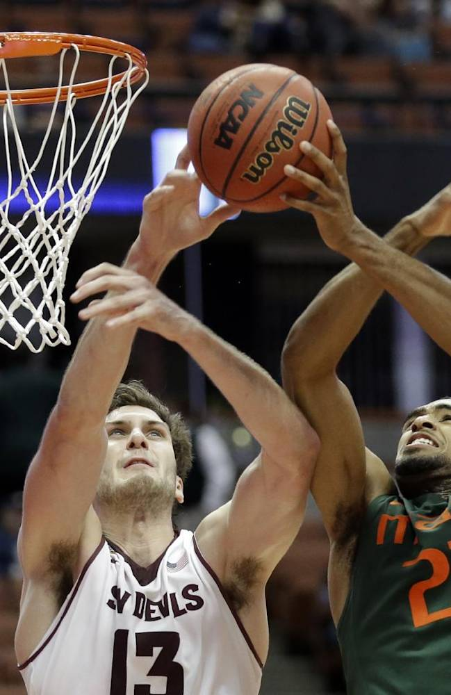 Miami forward Donnavan Kirk (22) shoots as Arizona State center Jordan Bachynski (13) defends in the second half of an NCAA men's college basketball game at the Wooden Legacy tournament in Anaheim, Calif., Sunday, Dec. 1, 2013. Miami won 60-57