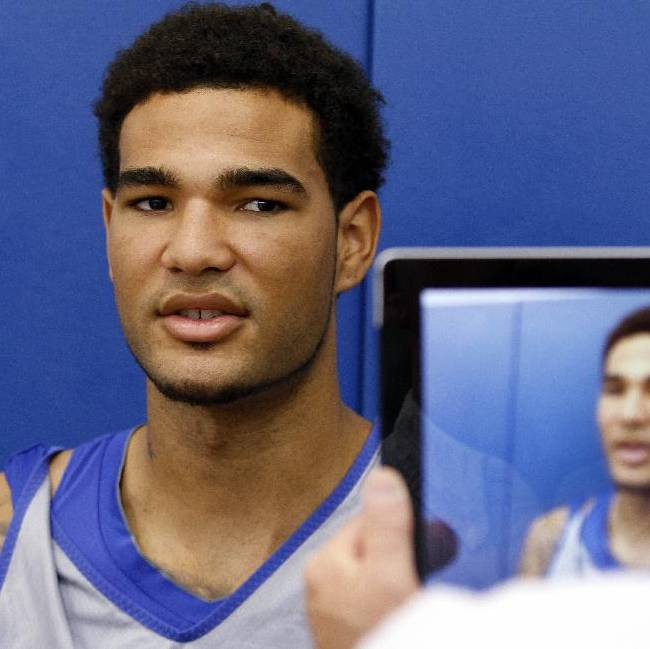 Kentucky's Willie Cauley-Stein listens to a question during the NCAA college basketball team's media day, Tuesday, Oct. 15, 2013, in Lexington, Ky