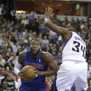 Detroit Pistons center Greg Monroe, left, goes to the basket against Sacramento Kings forward Jason Thompson during the first quarter of an NBA basketball game in Sacramento, Calif., Friday, Nov. 15, 2013 The Associated Press