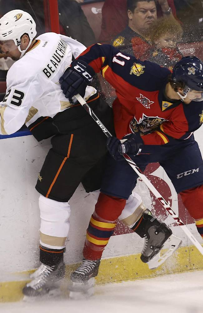 Anaheim Ducks' Francois Beauchemin (23) and Florida Panthers' Jonathan Huberdeau (11) vie for the puck during the first period of an NHL hockey game in Sunrise, Fla., Tuesday, Nov.12, 2013