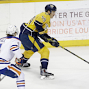 Nashville Predators defenseman Roman Josi (59), of Switzerland, moves the puck past Edmonton Oilers left wing Taylor Hall (4) in the first period of an NHL hockey game Thursday, Nov. 27, 2014, in Nashville, Tenn. The Predators won 1-0 in overtime The Asso