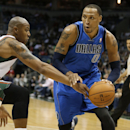 Dallas Mavericks' Shawn Marion, right, drives against Milwaukee Bucks' Caron Butler during the first half of an NBA basketball game Saturday, Nov. 9, 2013, in Milwaukee The Associated Press
