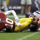 Washington Redskins' Robert Griffin III (10) is sacked by Houston Texans' D.J. Swearinger (36) during the first quarter of an NFL football game, Sunday, Sept. 7, 2014, in Houston The Associated Press