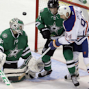 Dallas Stars goalie Kari Lehtonen, left, deflects the puck as teammate Dallas Stars defenseman Sergei Gonchar (55) ties up Edmonton Oilers left wing Ryan Smyth (94) during the first period of an NHL hockey game Sunday, Dec. 1, 2013, in Dallas The Associat