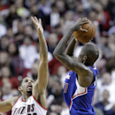 Los Angeles Clippers guard Jamal Crawford, right, puts up a three point shot against Portland Trail Blazers guard Allen Crabbe during the second half of an NBA basketball game in Portland, Ore., Wednesday, April 16, 2014. Crawford scored 34 points as the