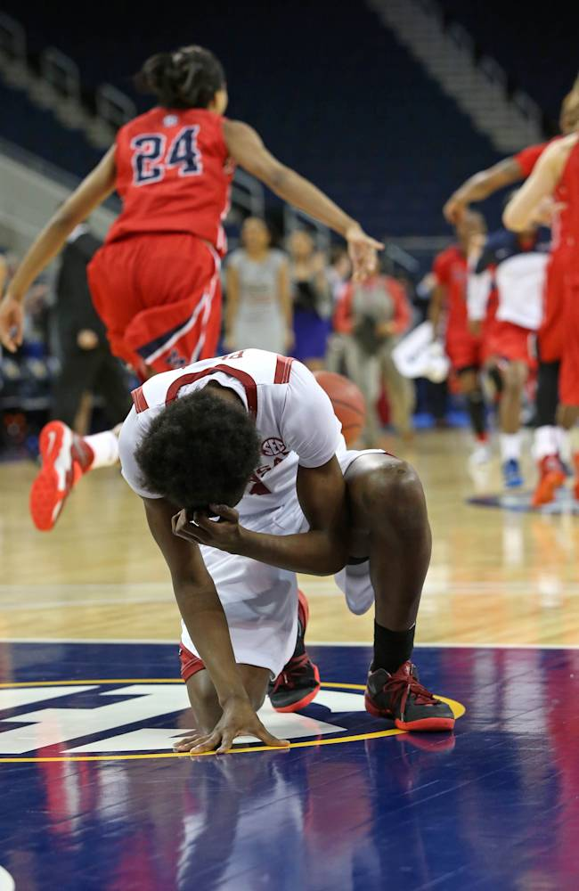 Arkansas forward Keira Peak reacts as Ole Miss celebrates their 63-62 win in the first round of the Women's Southeastern Conference NCAA college basketball game, Wednesday, March 5, 2014, in Duluth, Ga