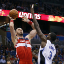 Washington Wizards center Marcin Gortat (4), of Poland, shoots over Orlando Magic center Dewayne Dedmon (3) during the first half of an NBA basketball game in Orlando, Fla., Friday, Apr. 11, 2014 The Associated Press