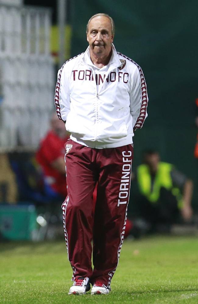 Torino coach Giampiero Ventura walks on the pitch during the Europa League play-off soccer match between Torino and Split, in Dugopolje, Croatia, Thursday, Aug. 21, 2014